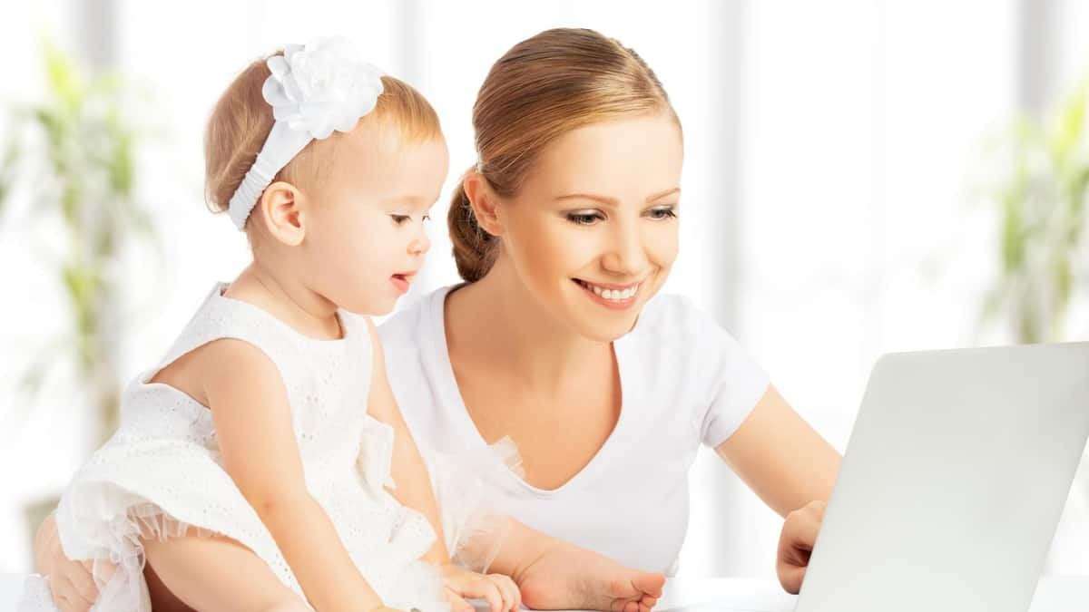 mom and baby blogging on laptop